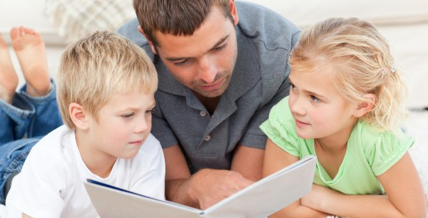 http://www.dreamstime.com/royalty-free-stock-photos-father-children-reading-book-floor-image17171048